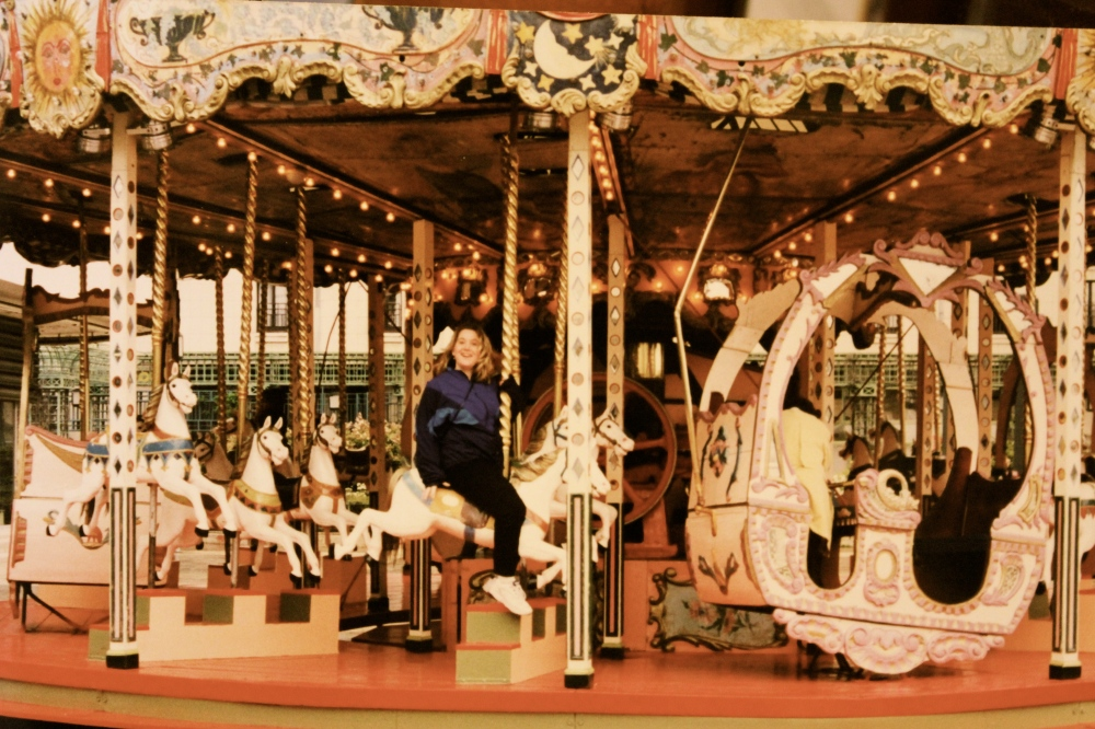 Heather on the carousel at Forum des Halles, Paris, France (1998)